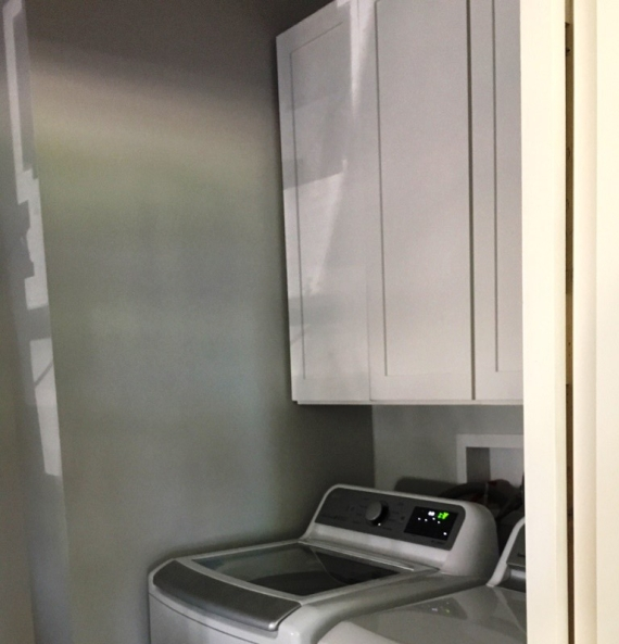 white cabinets in laundry room