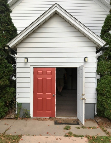 The front entryway of the church was added in the 1940s (originally, parishioners entered beneath the belfry). Glassed French doors were replaced at some point with the industrial red doors we found when we checked out the church a year ago.
